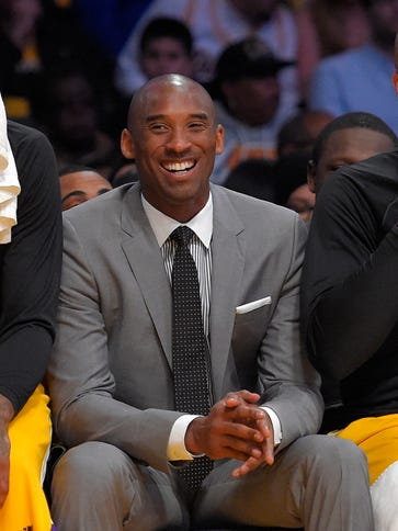 Los Angeles Lakers' Kobe Bryant watches from the bench