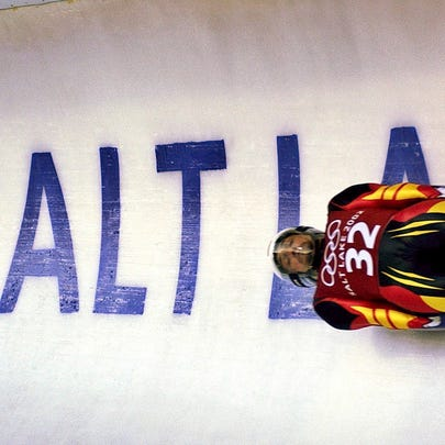 FILE - In this Feb. 9, 2002, file photo, Georg Hackl, of Germany, speeds past an Olympic logo during a practice run for the men's singles luge at the 2002 Salt Lake City Winter Olympics in Park City, Utah. The idea of the U.S. hosting a Winter Olympics is complicated. So says the leader of the team that brought the Summer Games to Los Angeles for 2028. LA 2028 chairman Casey Wasserman says his team would be supportive of a bid to bring the Winter Games to the United States. (AP Photo/Elise Amendola, File)