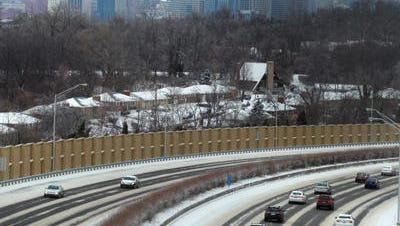 Traffic moves along cleared lanes on I-471 looking north from Highland Avenue in Fort Thomas in March, 2014.