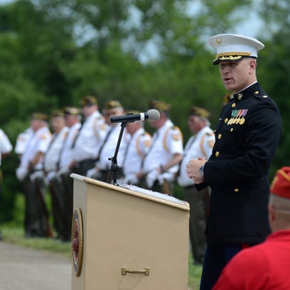 Marine Corps Maj. Shawn Myer speaks during the The
