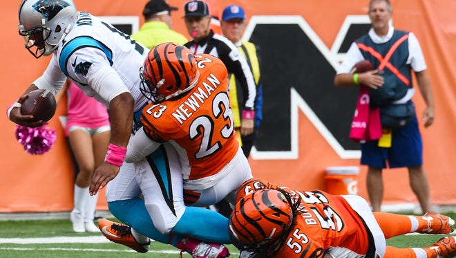 Oct 12, 2014; Cincinnati, OH, USA; Carolina Panthers quarterback Cam Newton (1) runs with the ball to score a touchdown as Cincinnati Bengals outside linebacker Vontaze Burfict (55) defends during the second half at Paul Brown Stadium. The Bengals and the Panthers tie in overtime 37-37. Mandatory Credit: Mike DiNovo-USA TODAY Sports