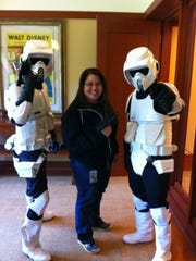 Kim Diaz a Chamorro from Guam and recruiting manager for Pixar,  poses with Stormtroopers at her office.