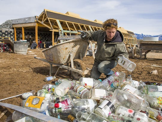 Heather Konz sorts through bottles to be recycled in
