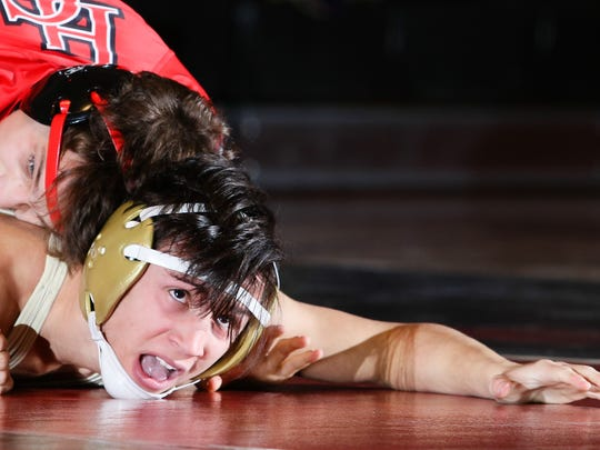 Hunterdon Central's Colton Washleski wrestles Monroe's Nicholas DePalma in the 113 pound bout during the Central Group IV wrestling semifinal at Hunterdon Central Field House in Flemington on February 08, 2018.