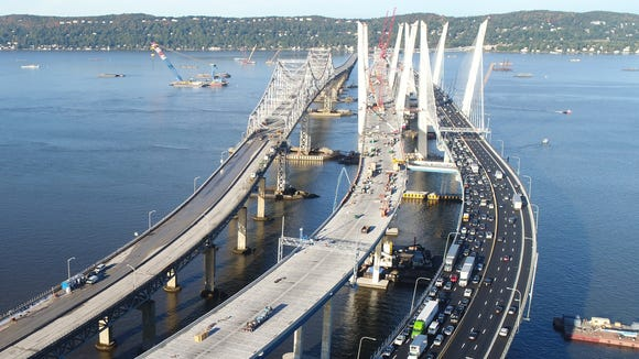 Morning rush hour traffic moves slowly toward Tarrytown on the Gov. Mario Cuomo Bridge on Oct. 10, 2017. At far left is the closed Tappan Zee Bridge. In the middle is the second span of the Cuomo Bridge, which will eventually carry eastbound traffic.