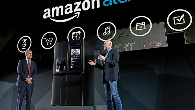 LG Electronics' vice president David VanderWaal and Amazon Echo vice president Mike George present the LG Smart InstaView Door-in-Door Refrigerator to CES 2017 attendees at the LG Electronics press conference in Las Vegas. Featuring InstaView technology and a smart touchscreen enabled with Amazon Alexa, users can y knock twice to see what's inside the refrigerator without opening the door  with Alexa voice control.     Because of the sudden acceleration of artificial intelligence and advancements in speech recognition and big-data storage, the technology behind virtual assistants is rapidly spreading from phones to cars and homes, and the truly useful helper is approaching fast.