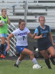 Boone County senior Morgan Black chases an opponent during Boone County's 5-1 win over Richmond Model in girls soccer Sept. 15, 2018 at Boone County HS, Florence KY. Rielyn Hamilton, an Akron commit, scored twice to set the new BCHS scoring record at 104 goals. during Boone County's 5-1 win over Richmond Model in girls soccer Sept. 15, 2018 at Boone County HS, Florence KY. Rielyn Hamilton, an Akron commit, scored twice to set the new BCHS scoring record at 104 goals. during Boone County's 5-1 win over Richmond Model in girls soccer Sept. 15, 2018 at Boone County HS, Florence KY. Rielyn Hamilton, an Akron commit, scored twice to set the new BCHS scoring record at 104 goals.
