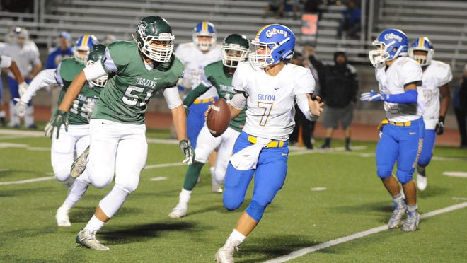 Alisal High's Carlos Mendoza chases down Gilroy quarterback Jon Jon Castro during the first quarter Friday night.