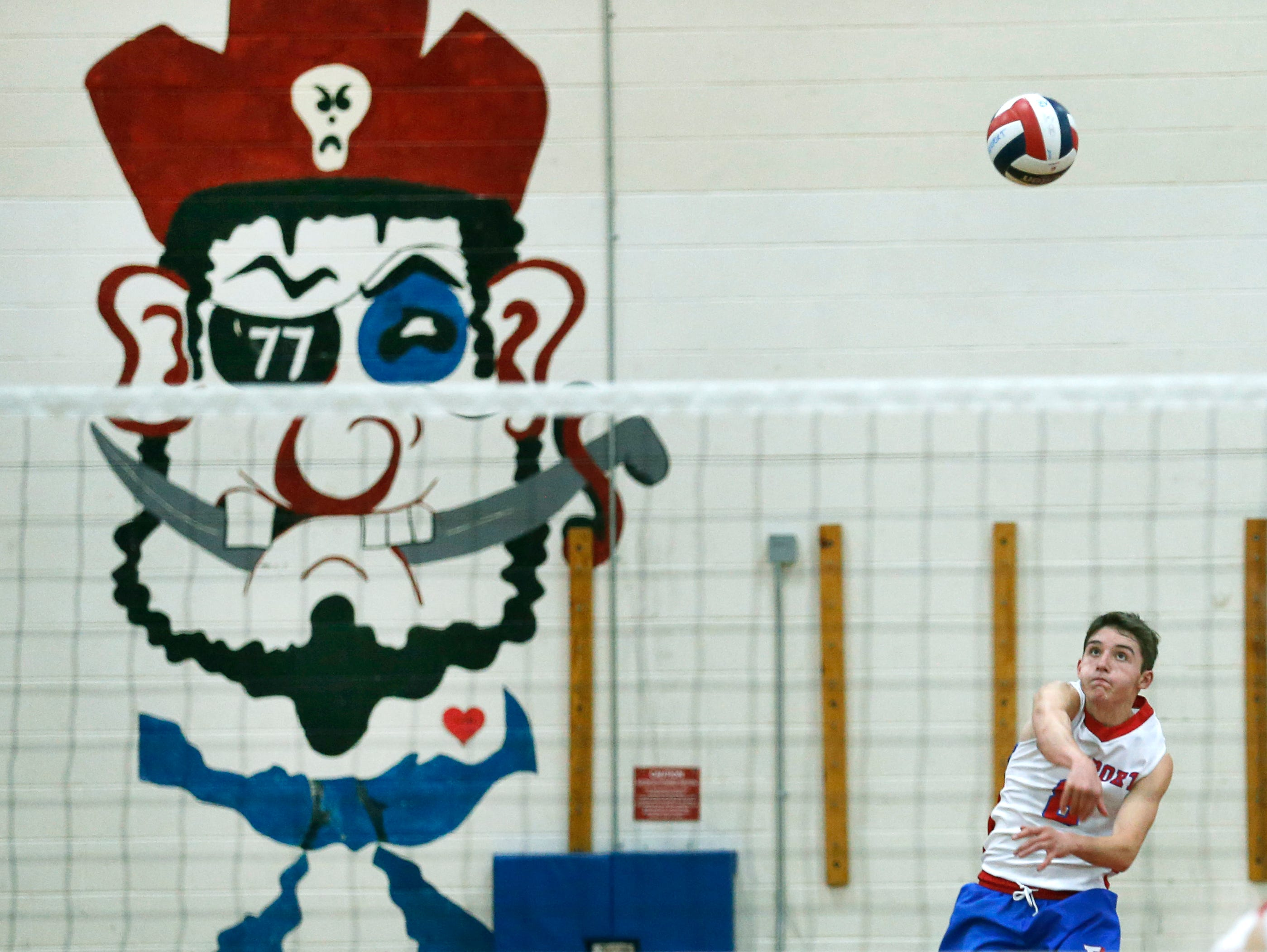 Fairport's Chad Riorden serves against Victor in the second set at Fairport High School.