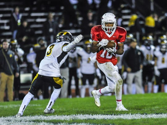 Manalapan wide receiver Symir Blacknall makes a catch in front of Piscataway's Nahjir Woods during a game in Manalapan on Oct. 27, 2017