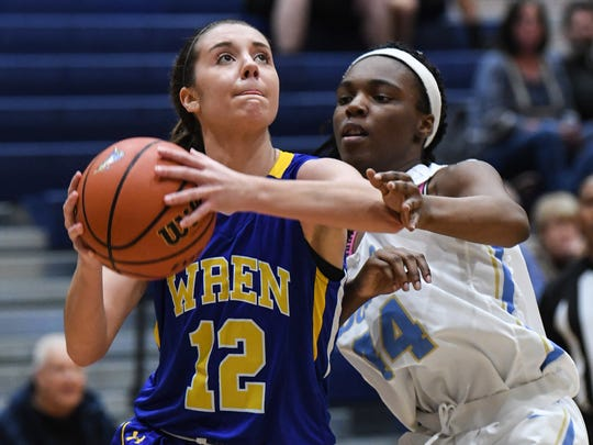 Wren senior Alex Lavore dribbles near Daniel junior Saterra Coleman during the third quarter at D.W. Daniel High School in Central on Tuesday.