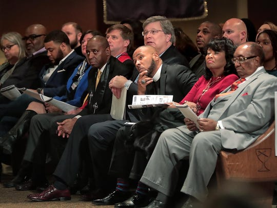 Memphis community leaders, politicians, and clergy listen to a scripture reading during a special Jubilee Worship service sponsored by the Memphis Christian Pastors Network at Mississippi Blvd Christian Church to honor the 50th anniversary of the sanitation workers strike.