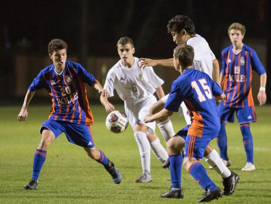 Nelson Libbert (9) tries to dribble the ball between