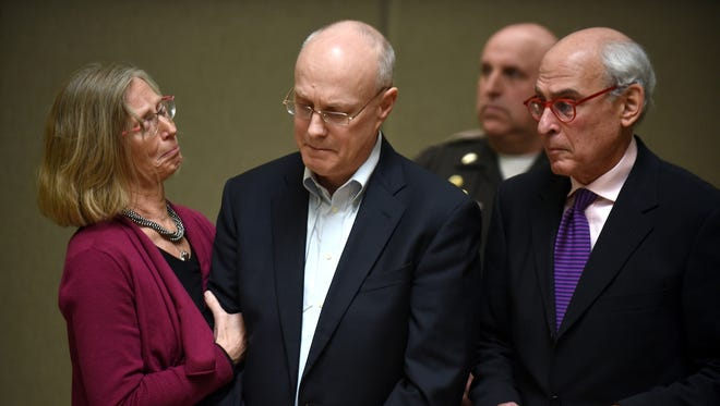 Robert Dellinger is flanked by his attorneys Lucy Karl and Steve Gordon while his sentence is read by the judge in Grafton Superior Court in North Haverhill, N.H. Thursday, April. 2, 2015. Dellinger, a former Fortune 500 executive from New Hampshire was sentenced to between nine and 20 years in prison for causing a highway crash that killed a Vermont couple and their unborn fetus.