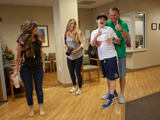 Family members, friends and hospital staff hold a celebration to honor the return of Britton Shipp to his home Friday, April 10, 2015.