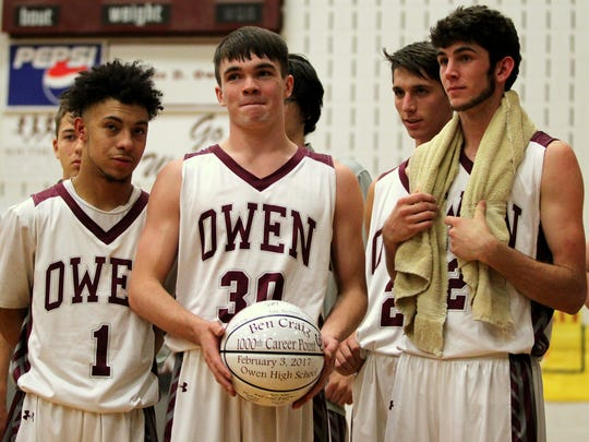 As a junior at Owen High School, Ben Craig (center) was one of three Warhorses to achieve 1,000th points in a career.