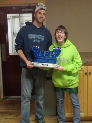 Brandon Paplham of Precision Machine, left, helped raise funds through wellness for the Special Olympics that his sister Erica Paplham participates in each year.