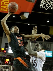 Earvin Morris goes in strong for the dunk during the