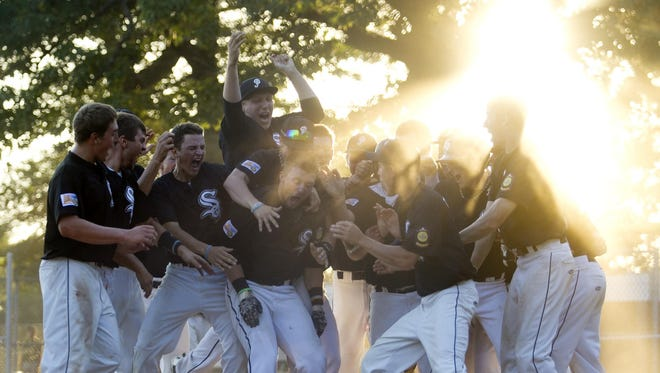 The Plover Black Sox celebrate a win in the state Class AAA American Legion baseball regional on July 23. The team begins play in the national tournament on Wednesday.