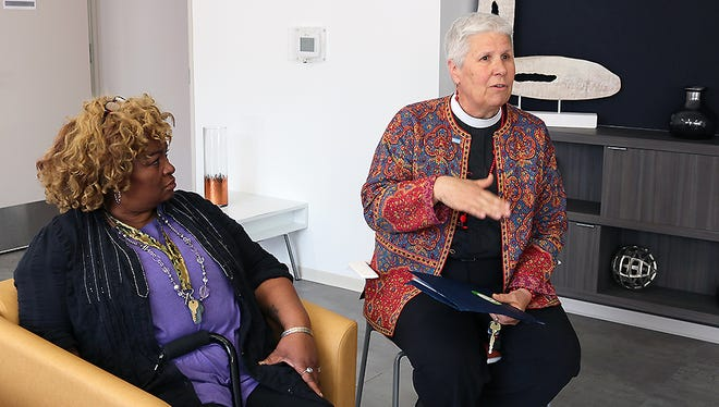 Rosalind Stewart, left, sits with Linda Kaufman, formerly with Community Solutions, which helped build an apartment building in Washington, D.C. for formerly homeless people including Stewart.