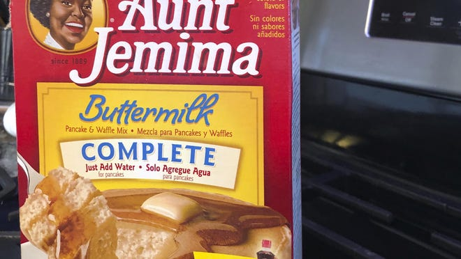 A box of Aunt Jemima pancake mix sits on a stovetop Wednesday, June 17, 2020, in Harrison, N.Y. Pepsico is changing the name and marketing image of its Aunt Jemima pancake mix and syrup, according to media reports.  A spokeswoman for Pepsico-owned Quaker Oats Company told AdWeek that it recognized Aunt Jemima's origins are based on a racial stereotype and that the 131-year-old name and image would be replaced on products and advertising by the fourth quarter of 2020. Quaker did not say what the name would be changed to.
