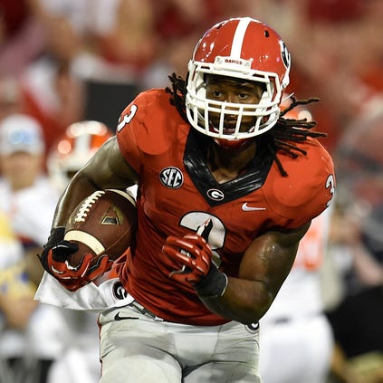 Aug 30, 2014; Athens, GA, USA; Georgia Bulldogs running back Todd Gurley (3) runs against the Clemson Tigers during the second half at Sanford Stadium. Georgia defeated Clemson 45-21. Mandatory Credit: Dale Zanine-USA TODAY Sports