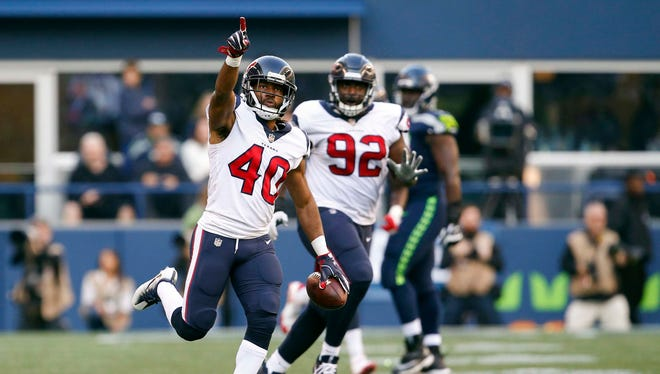 Houston Texans cornerback Marcus Williams (40) celebrates after intercepting a pass against the Seattle Seahawks during the fourth quarter at CenturyLink Field.