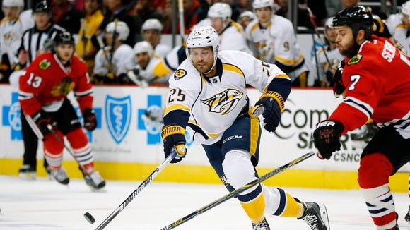Predators left wing Viktor Stalberg (25) battles Blackhawks