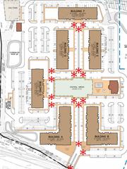 A conceptual plan shows six apartment buildings surrounding