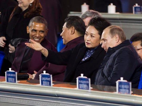 President Obama, left, speaks with Chinese President