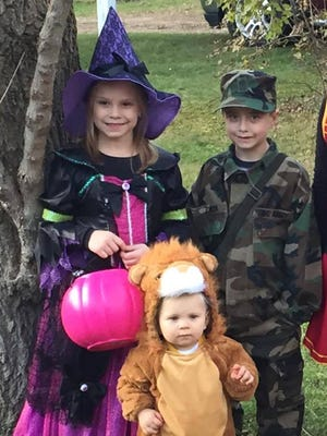Cousins Isabelle Knutson dressed as a witch, Jameson Zinda dressed as a soldier and Logan Knutson dressed as a lion trick-or-treated in Rosholt on Sunday.