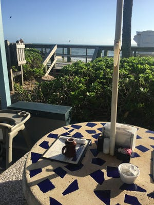 Although Seaside Grill has seating inside, many people prefer to grab a table outside under the umbrellas for the ocean view and people watching.