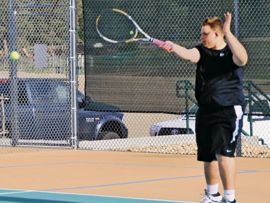Senior Danny Myers, of Ruidoso High School, prepares for the first round of state tournament play, Wednesday.