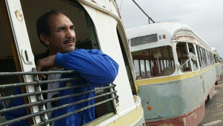 Sun Metro Maintenance Manager Gabriel Muñoz peers from the window of a 1930's trolley car that once operated Downtown.