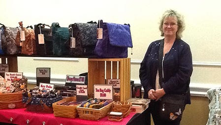 Lauren Ferguson of LaMa Bags stands next to her booth at the 2013 Wool and Fiber Expo in Ocean City, Maryland. This year's event will be held Feb. 10-12, 2017.