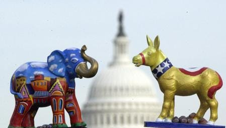 Painted tabletop models of the Republican elephant and the Democratic donkey, right