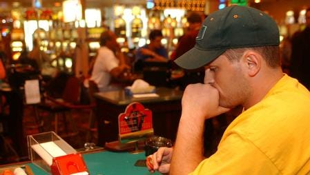 Happier times: Matt Freije, from Brownburg, Indiana, ponders his cards while playing blackjack in 2005
