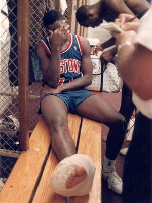 Isiah Thomas sits in the locker room at The Forum, his ankle wrapped, after the Pistons' 103-102 loss in Game 6 of the NBA finals June 19, 1988 in Inglewood, Calif.