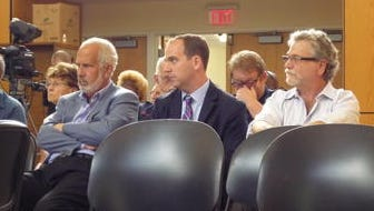 From right, Jeffrey Goldstein, Joshua Goldstein, and Richard Sirota attend a recent Ramapo Town Board meeting during which the board approved a 40-year tax agreement for their proposed development, the Orange Avenue project.
