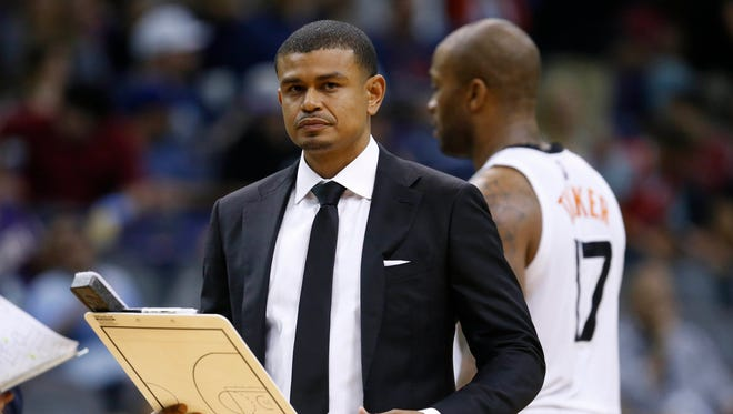 Phoenix Suns interim head coach Earl Watson takes a break during a timeout in a game at Talking Stick Resort Arena in Phoenix on April 13, 2016.