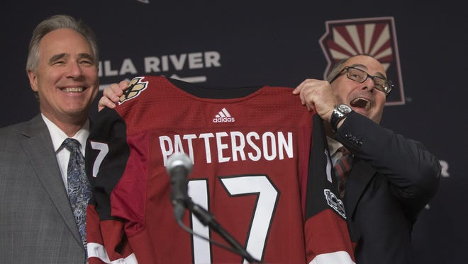 Coyotes owner Andrew Barroway holds up a jersey for Coyotes President Steve Patterson during a press conference at Gila River Arena in Glendale, Ariz. on July 13, 2017.