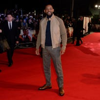 """Will Smith poses for photographers at the screening of Focus, at a central London cinema. Once the biggest box office star in the world, after the failure of the big budget """"After Earth,"""" Smith has entered another phase in his career and life where box office results don't define him. First up is """"Focus,"""" a character study about a con-man and his young protege, played by up and comer Margot Robbie."""