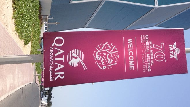 In this photo from May 31, 2014, a banner in the West Bay area of Doha, Qatar,  welcomes attendees to the 70th Annual General Meeting for the International Air Transport Association. The event begins June 1.