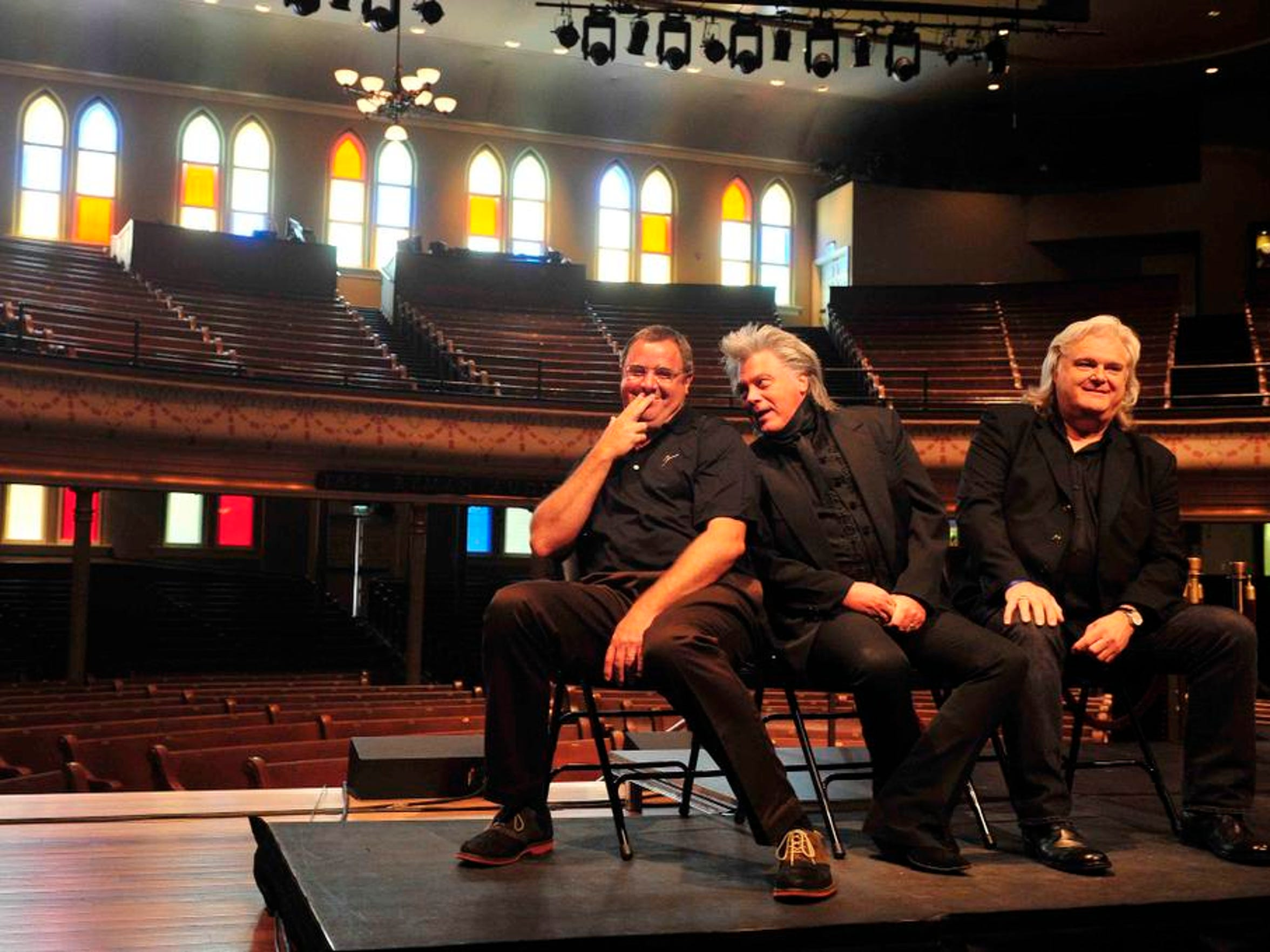 Vince Gill, Marty Stuart  and Ricky Skaggs listen during an expansion announcement at the Ryman in downtown Nashville, Tenn. on June 26, 2014.