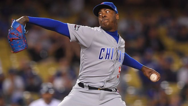 Chicago Cubs relief pitcher Aroldis Chapman throws during the ninth inning of Game 5 of the National League baseball championship series against the Los Angeles Dodgers Thursday, Oct. 20, 2016, in Los Angeles. (AP Photo/Mark J. Terrill)