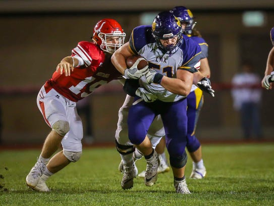 Webster City's (51) Cooper Lawson runs upfield with