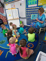 Kindergarten Teacher, Mary Mertins, begins the first day of school with story time for her new students at Pea Ridge Elementary School in Santa Rosa County. Students in both Escambia and Santa Rosa Counties returned to the classroom this morning, Monday Aug. 17, 2015.