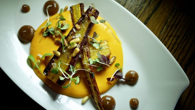 First course of roasted carrots with cumin, date puree, walnuts and carrot creme, is served during the Detroit Free Press Top 10 Takeover dinner series at Ale Mary's in Royal Oak on Monday, Sept. 21, 2015.