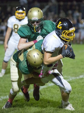York Catholic's Matthew Brewer tackles Littlestown's