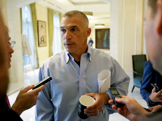 Former New York Yankees manager Joe Girardi talks with reporters at the annual MLB  general managers' meetings, Tuesday, Nov. 14, 2017, in Orlando, Fla. (AP Photo/John Raoux)